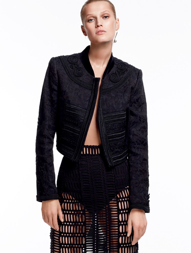 Toni models a cropped jacket with cut-out embellished skirt