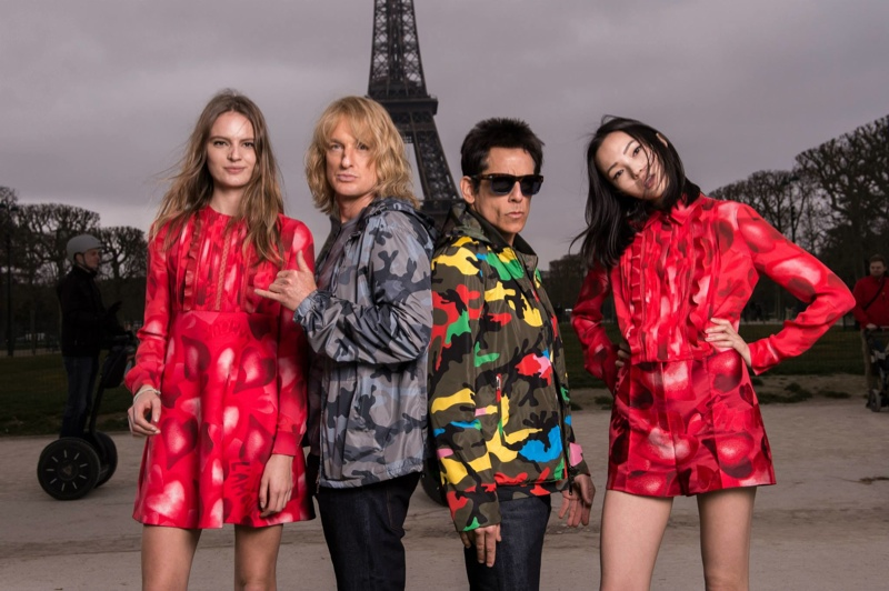 Ben Stiller and Owen Wilson pose with Tilda Lindstam and Xiao Wen Ju at the Eiffel Tower. Photo via Valentino.