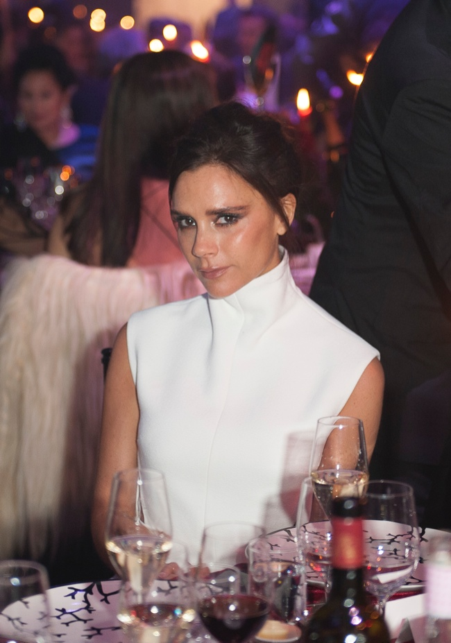 Victoria Beckham wears a Victoria Beckham dress in white.