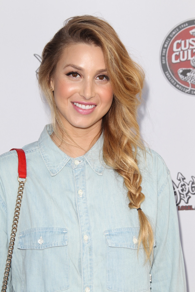 Whitney Port wears a loose braided hairstyle. Photo: Shutterstock.com.