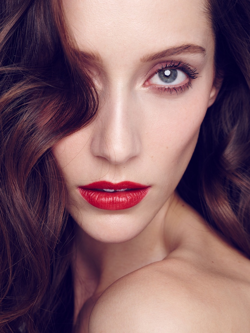 Alana wears a fiery red lip in this image