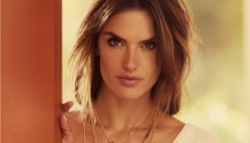 The VIctoria's Secret Angel models a layered necklace
