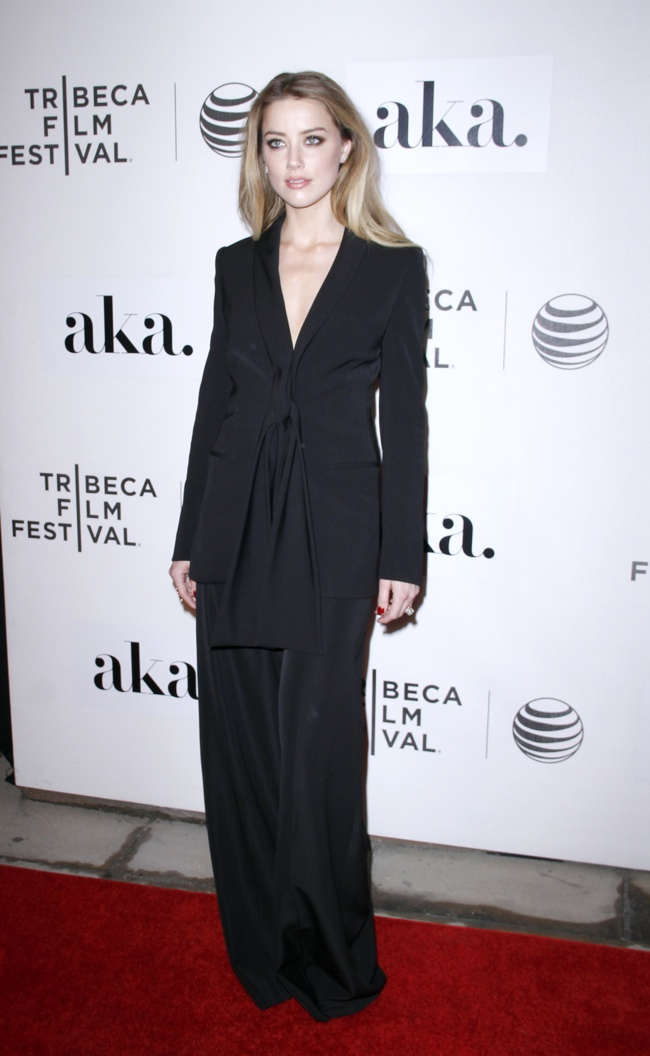 """Amber Heard suited up in a black Stella McCartney pant suit at the 2015 Tribeca Film Festival World Premiere of """"The Adderall Diaries"""". Photo: M Van Niedek / PRPhotos.com"""