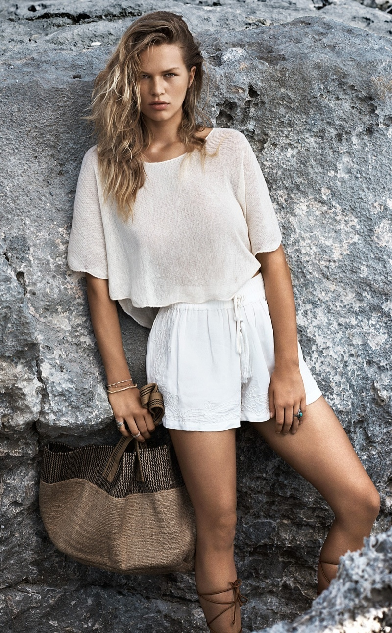 The blonde beauty wears  all white looks from the brand's summer catalogue