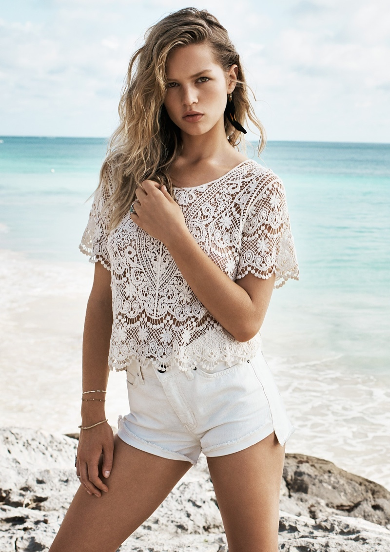 Anna Ewers wears a lace top and white shorts from Mango