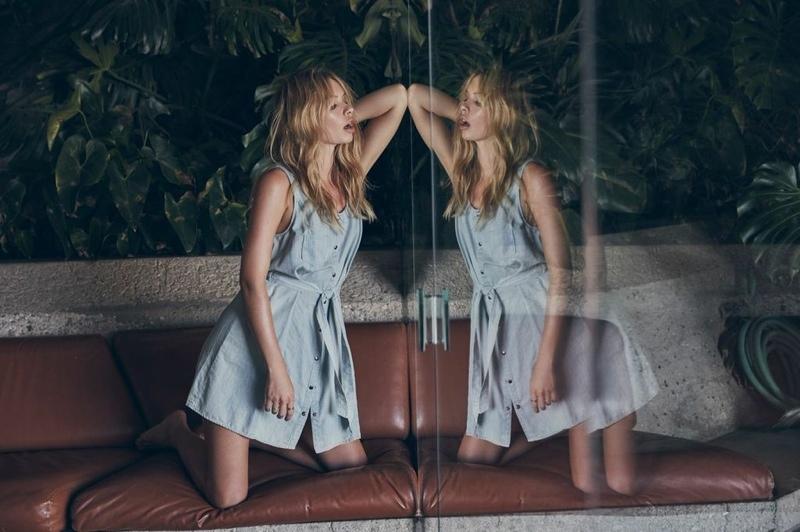 Alexandra wears a light washed denim dress from BB Dakota
