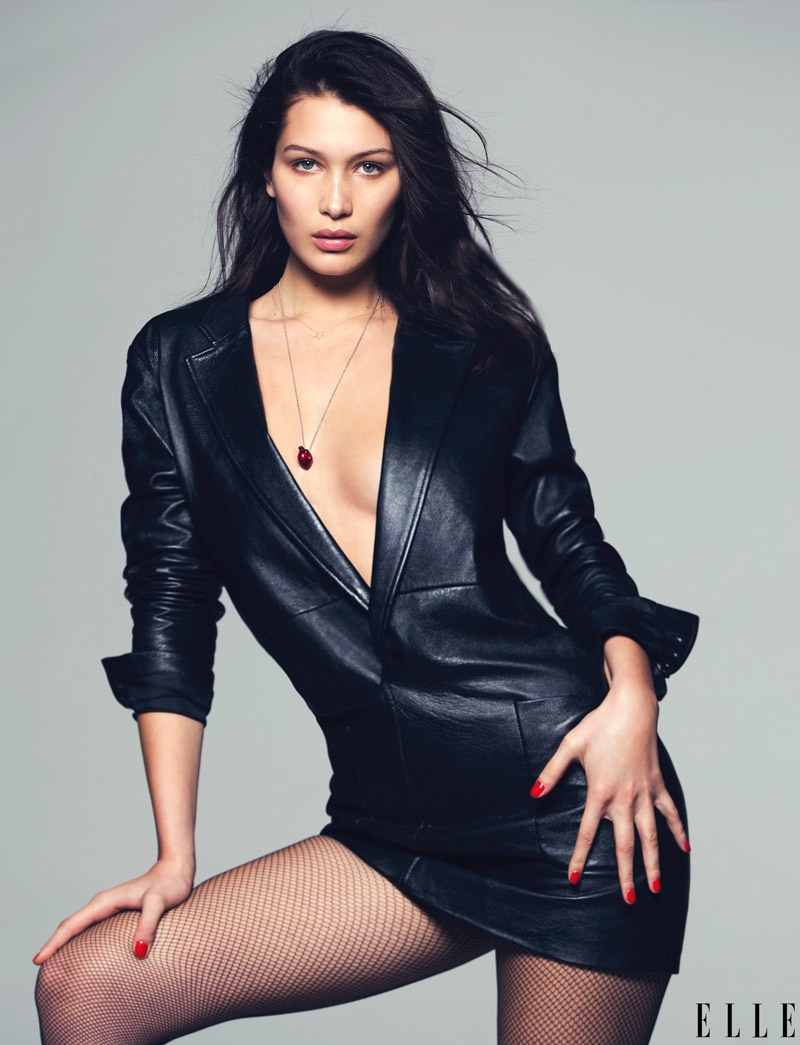 The American model sports a v-neck Saint Laurent dress