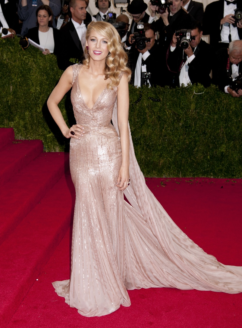 Actress Blake Lively was perfectly glamorous and statuesque in a Gucci Première gown at the 2014 Met Gala. The blonde bombshell looked to step out of the silver screen in the 50s with this sparkling dress. Photo: Janet Mayer / PR Photos