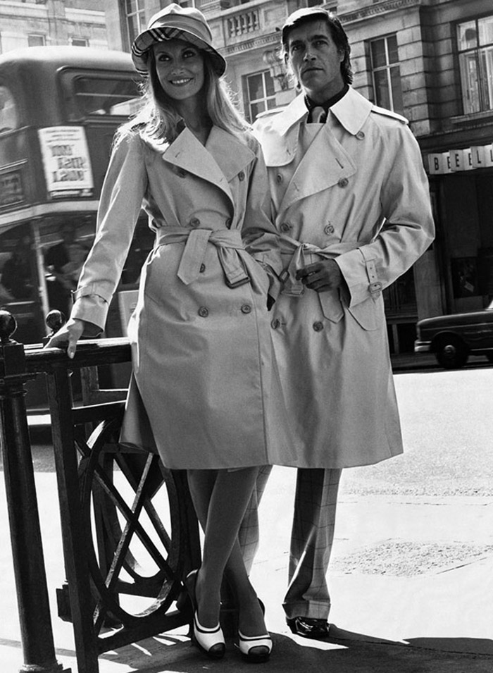A Burberry advertisement from 1973 featuring models in trench coats