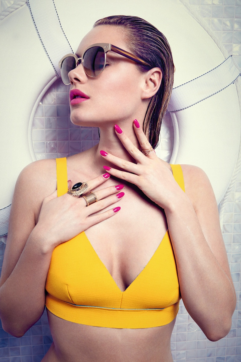 Camille models a vibrant yellow swim top in this image