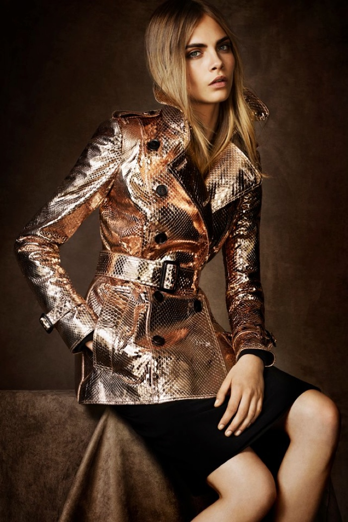 Cara Delevingne wears a metallic version of the Burberry trench coat in 2012