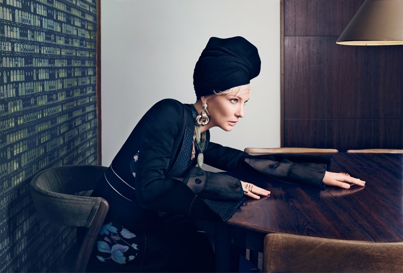 The Australian actress channels vintage style with a head wrap and dangling earrings.