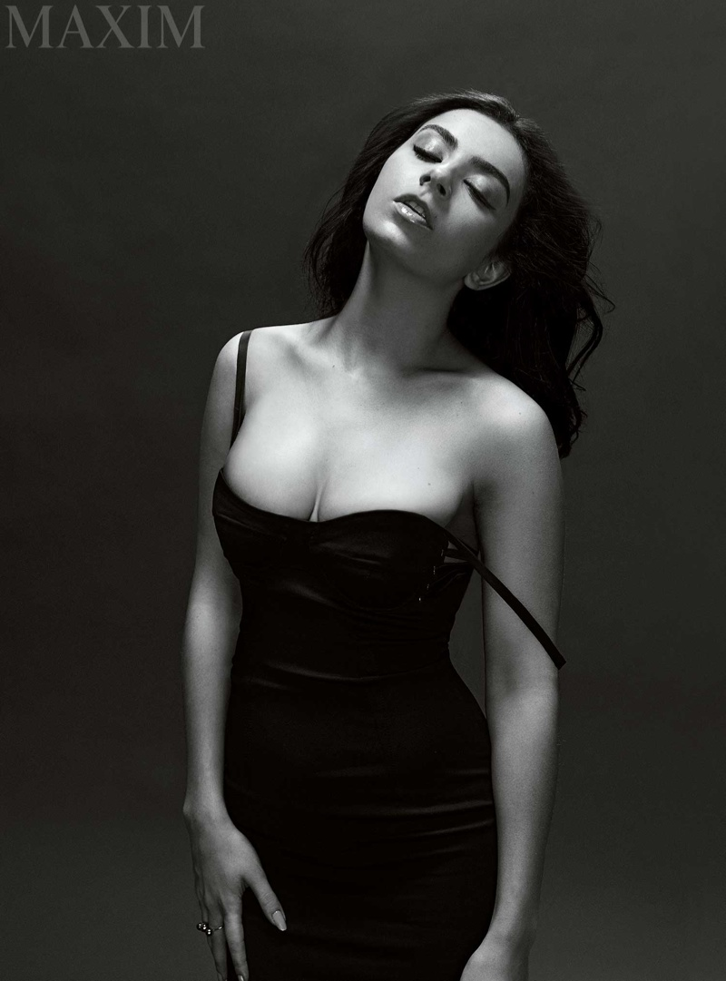 Charli wears a revealing black dress in the photo shoot