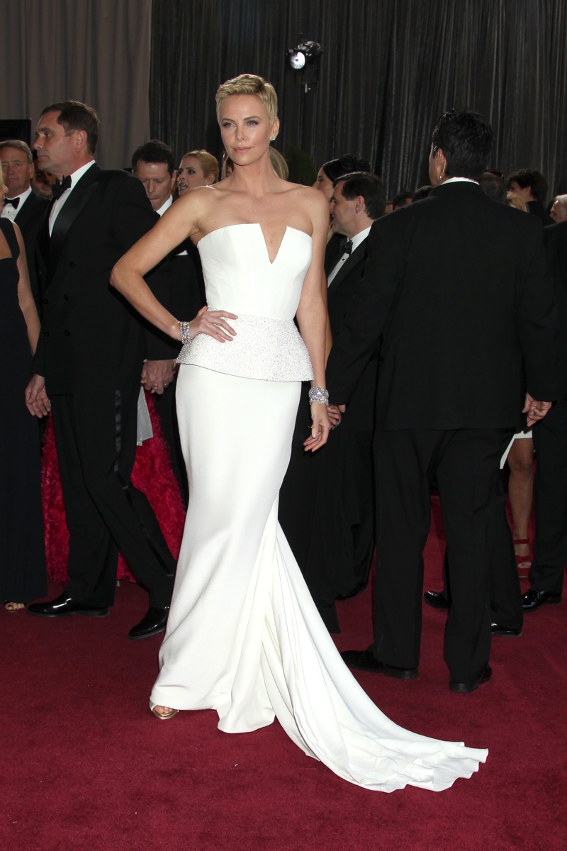 With her short hairdo, Charlize Theron stole the show at the 2013 Oscars wearing a white Dior Haute Couture gown. Helga Esteb / Shutterstock.com