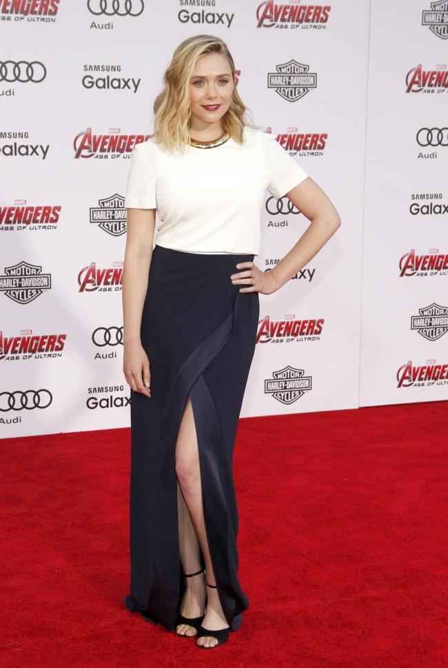 Elizabeth Olsen opted for a white tee and long skirt from Galvan. Cobie Smulders wore a form-fitting blue and white Bibhu Mohapatra dress. Photo: David Gabber / PRPhotos.com