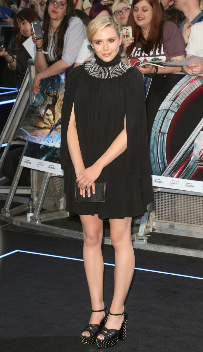 Elizabeth Olsen in Saint Laurent black cape dress at  'Avengers: Age of Ulton' London premiere. Photo: Landmark / PRPhotos.com