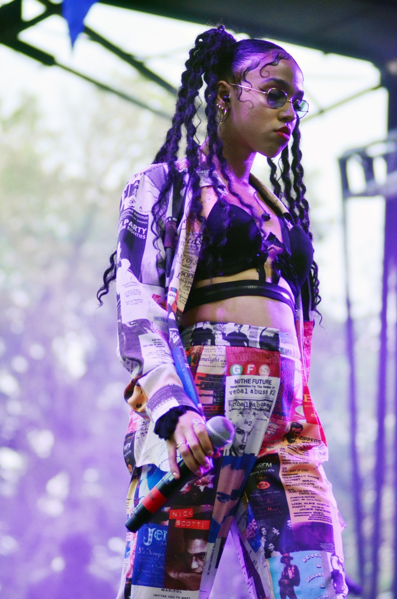In concert at the 2014 Pitchfork Music Festival, FKA Twigs wears a bralette with high-waist trousers and a matching jacket. Photo: Daniel Locke / PR Photos