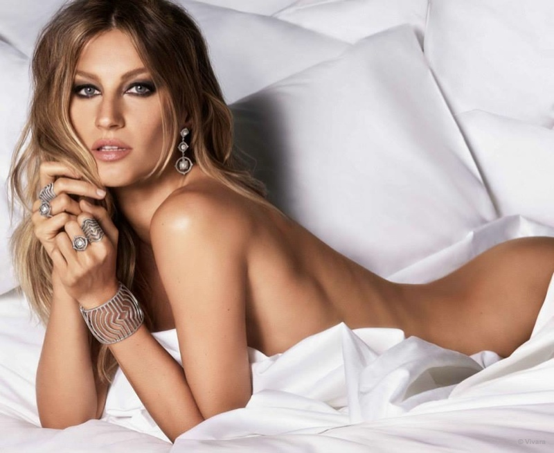 The Brazilian supermodel poses naked in bed for the sultry advertisements.