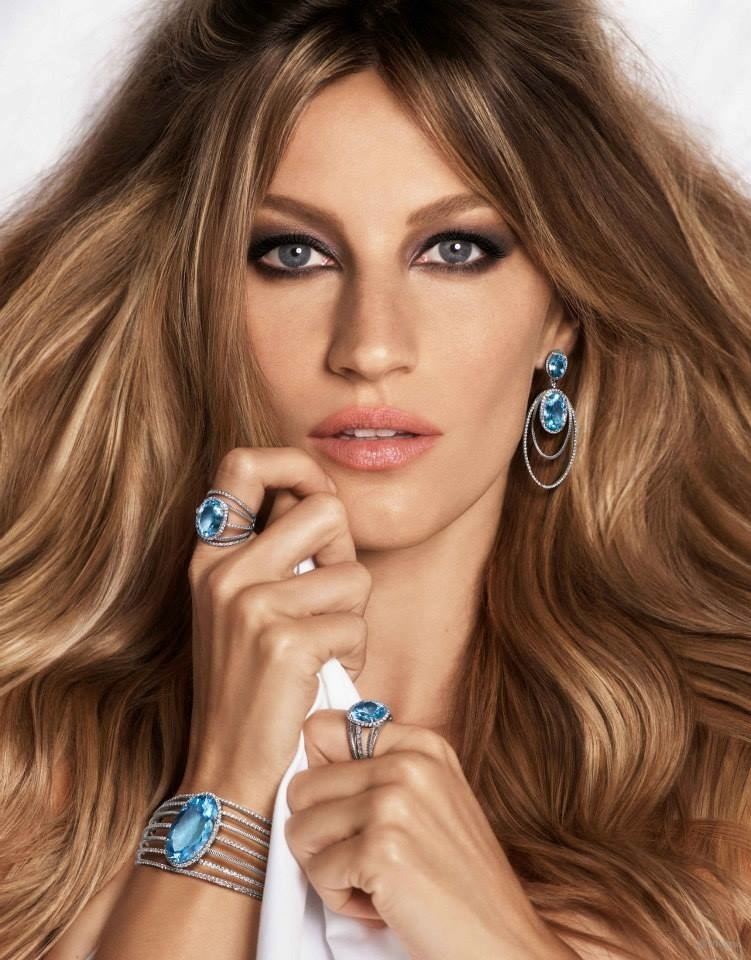 In a closeup, Gisele and the jewelry compete for attention.