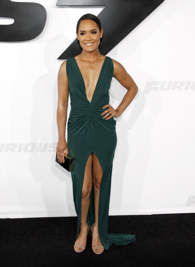 Grace Gealey opted for a green dress with a plunging neckline and high ...