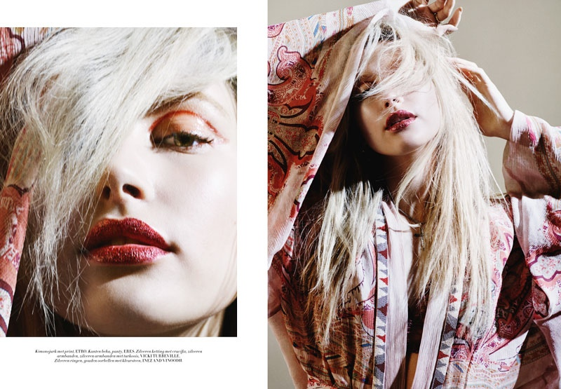 Deep red lipstick and pale white hair serve as major beauty inspiration