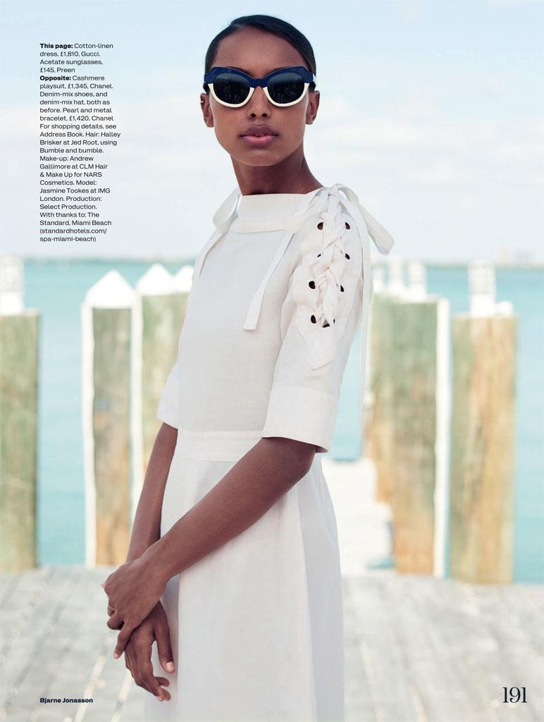 Jasmine wears a white Gucci dress