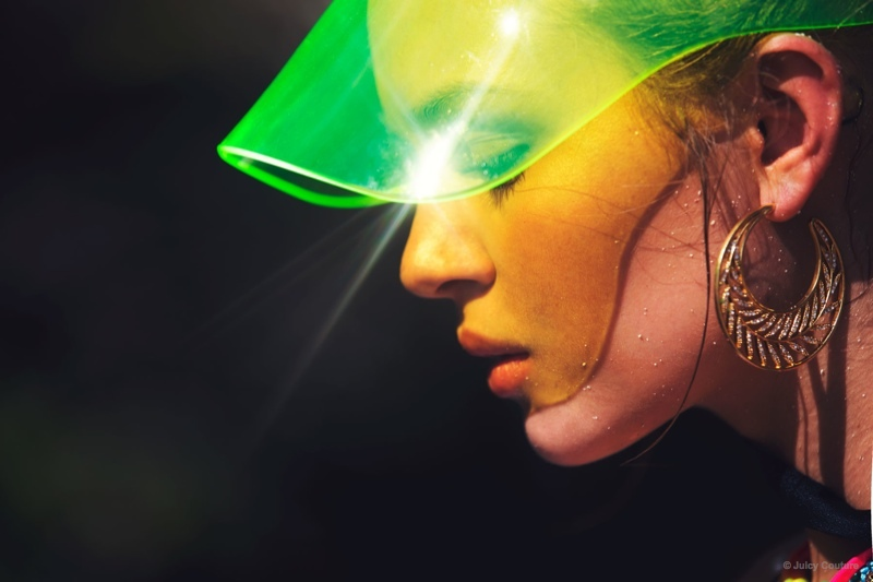 Josephine protects herself from the sun with a neon green visor