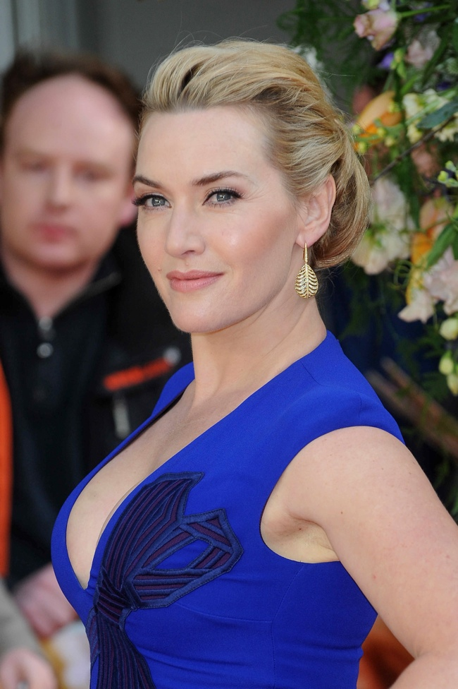 Kate Winslet paired her blue dress with a sleek updo hairstyle. Photo: Solar Pix PRPhotos.com