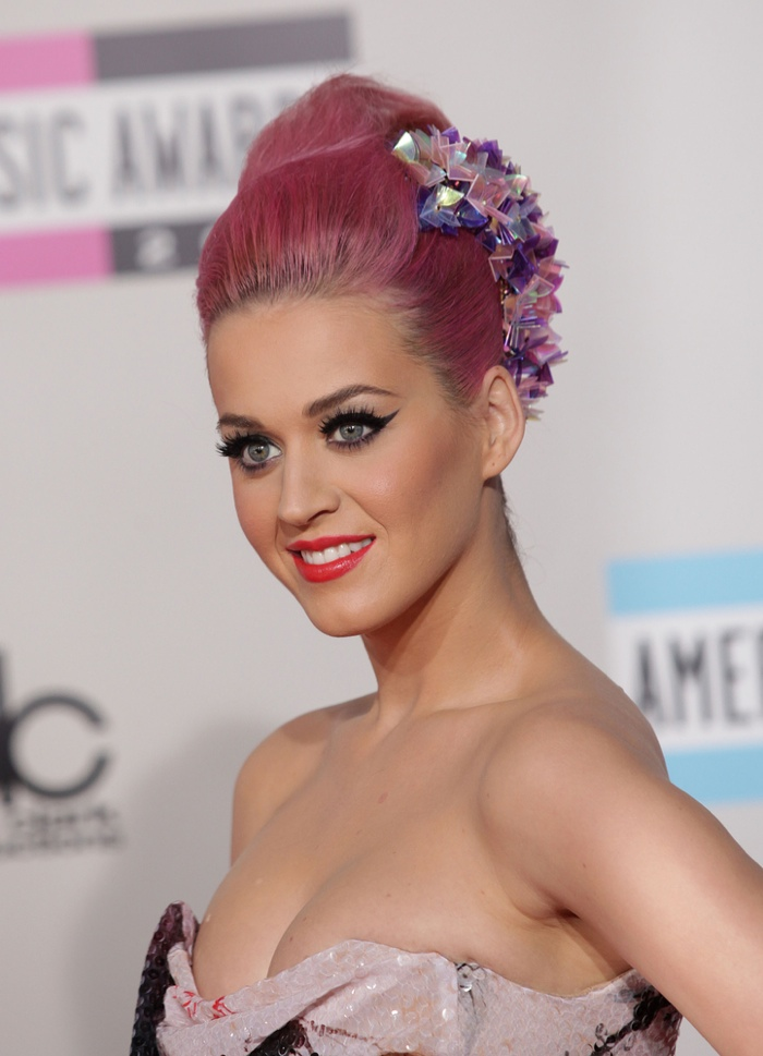 Katy Perry is always changing up her hair color. Here she is with a pink updo. Photo: DFree / Shutterstock.com
