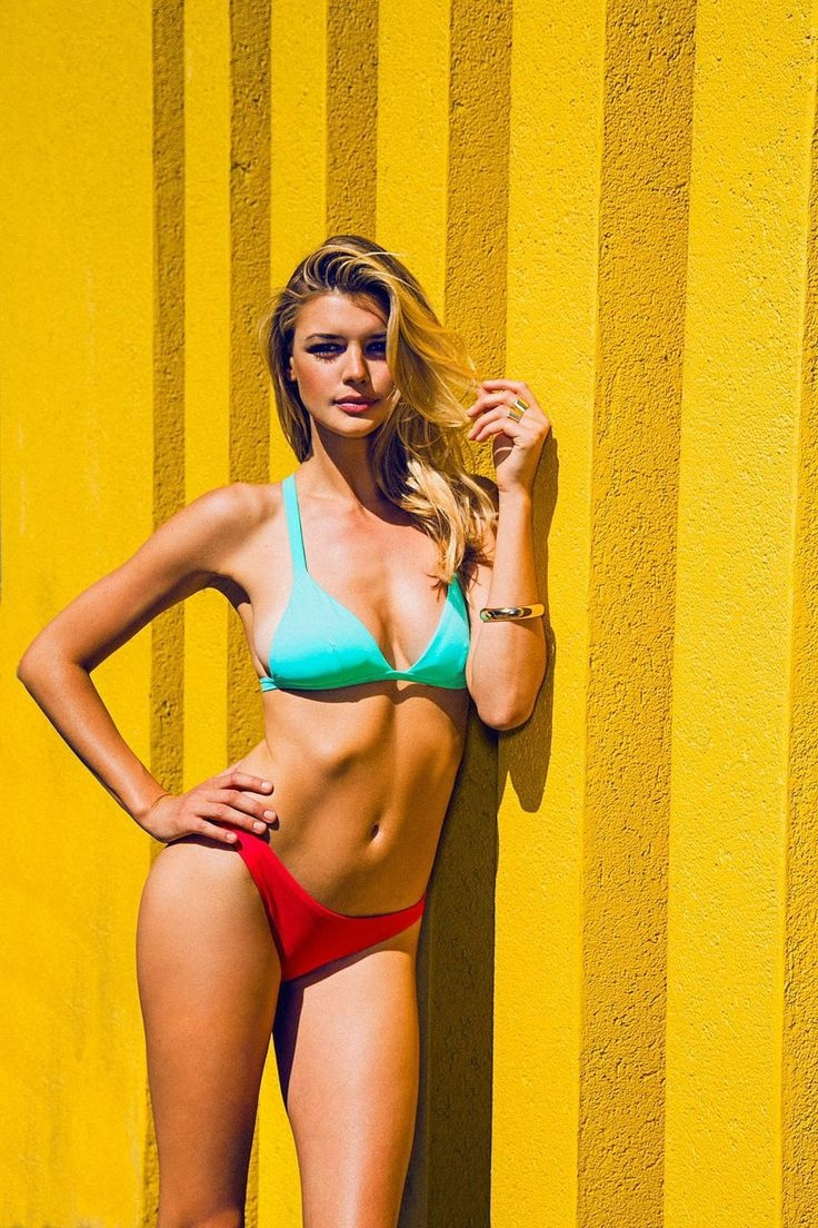 Kelly looks ready for summer in bold neon colors and sexy cuts.