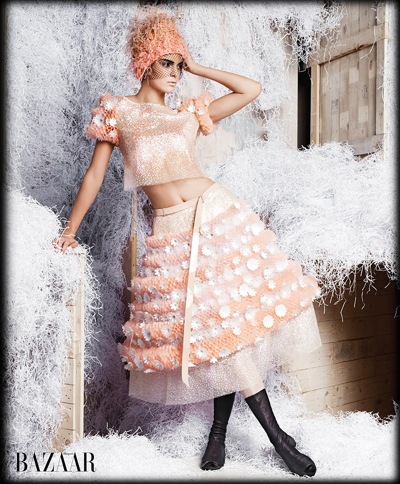 The it model wears Chanel Haute Couture in this image
