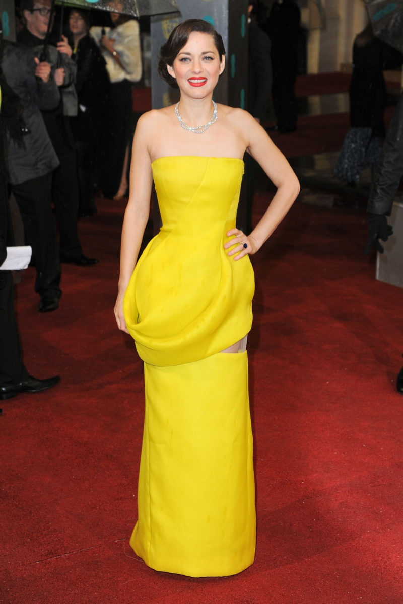 French actress Marion Cotillard went for a bold yellow statement in a yellow Dior Haute Couture spring 2013 gown at the 2013 BAFTA Awards. Featureflash / Shutterstock.com