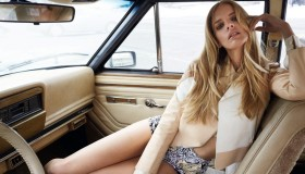 Marloes wears a color-blocked jacket, crop top and print shorts
