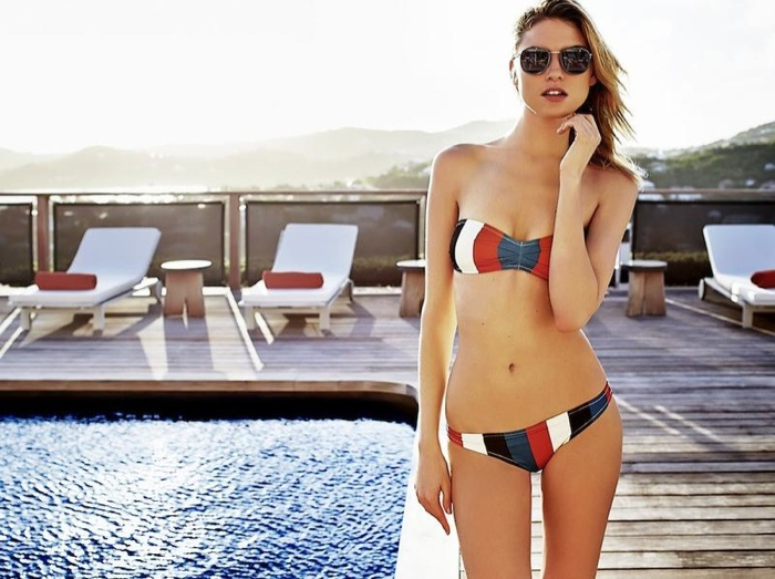 Martha wears a striped two-piece swimsuit look