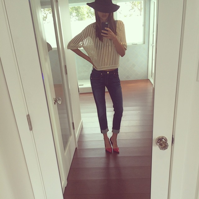 Miranda Kerr wears a slim-fit boot-cut jean. Photo via Instagram.