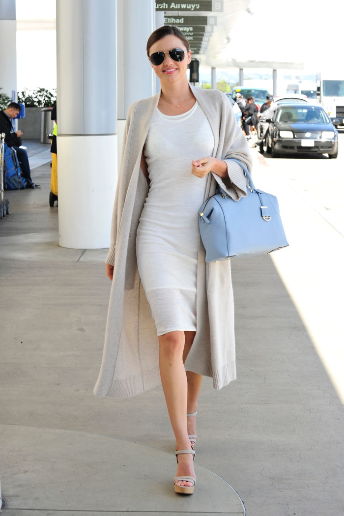 Miranda Kerr looks ladylike in a coat and dress ensemble with the MICHAEL Michael Kors 'Riley' Satchel in pale blue. Photo: StarTraks Photo