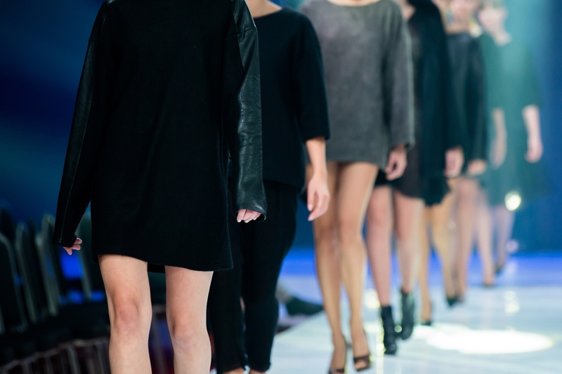 Models walk on a Paris runway. Photo: martinkay / Shutterstock.com