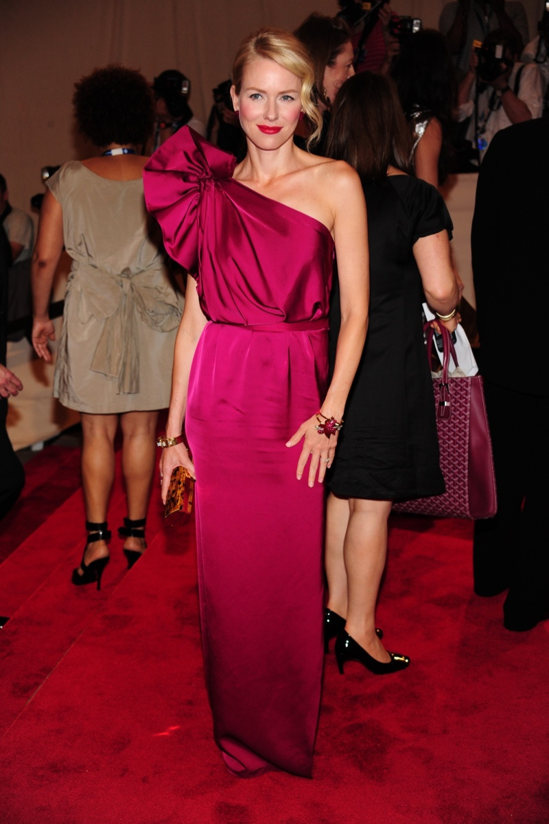 Naomi Watts looked classic in a fuchsia colored Stella McCartney gown featuring a large bow decoration on one sleeve at the 2010 Met Gala. Photo: Everett Collection / Shutterstock.com
