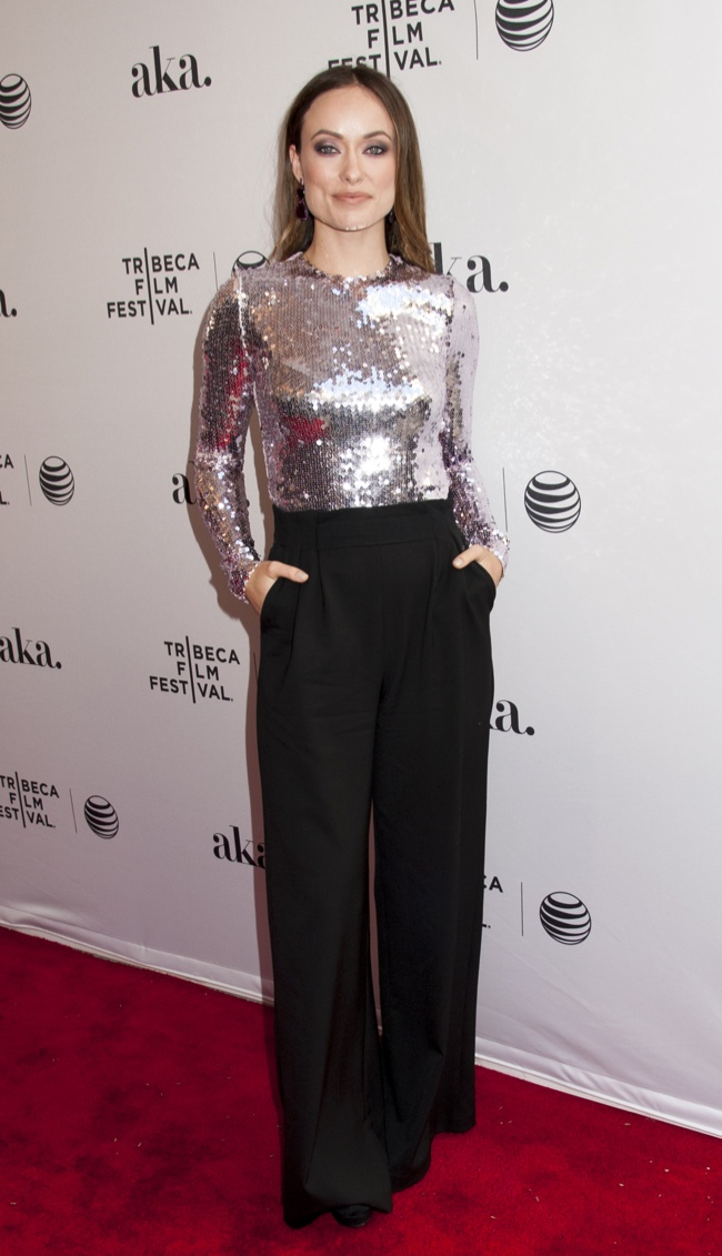 Olivia Wilde shined in a metallic silver Dior top and black pants. Photo: Janet Mayer / PRPhotos.com