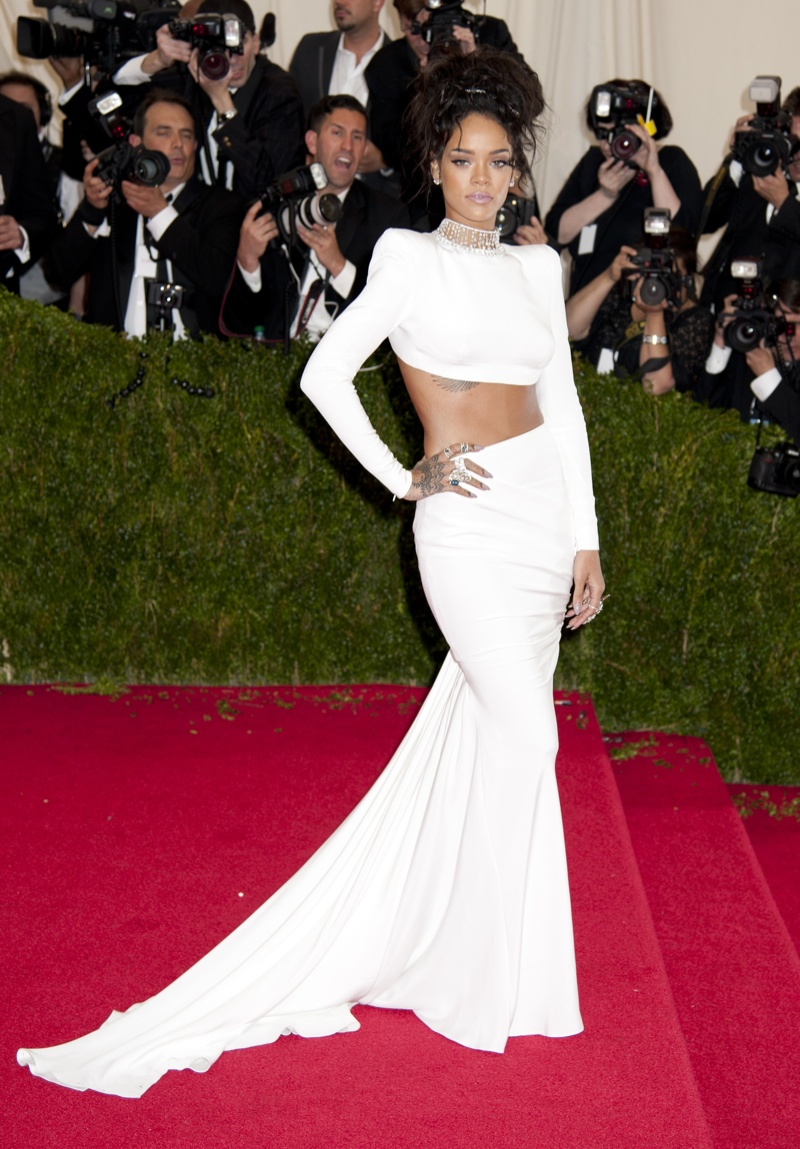 Rihanna went for a bold white crop top look and skirt from Stella McCartney at the 2014 Met Gala. We think the daring risk paid off as one of the best looks of that year. Photo: Janet Mayer / PRPhotos.com