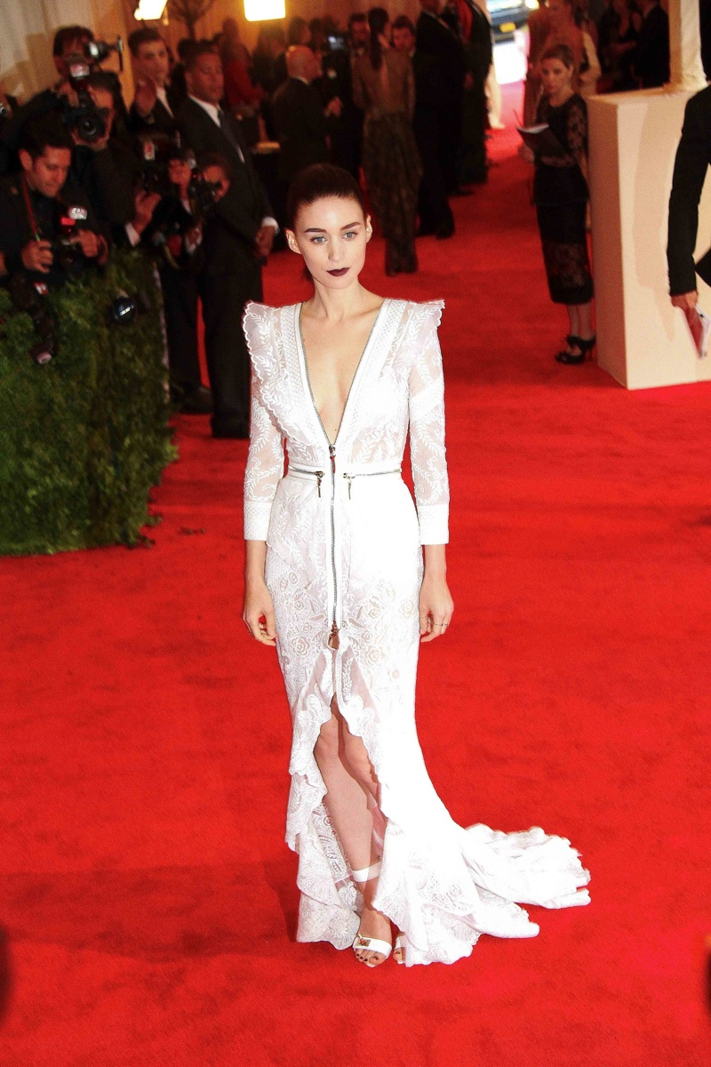Rooney Mara went for a sculptural Givenchy Haute Couture gown at the 2013 Met Gala which had a punk theme. With a dark lip and slicked back hairstyle, Rooney gave a rebellious yet refined take on the style. Photo: Wild1 / PR Photos