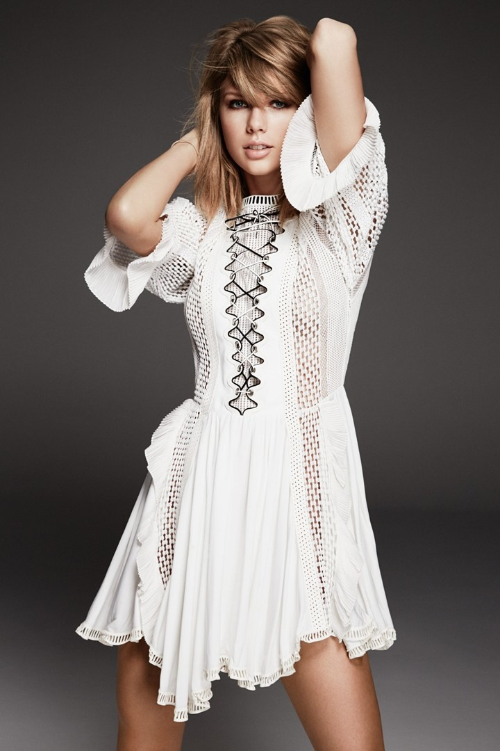 Taylor wears a white Louis Vuitton dress from the label's spring 2015 collection