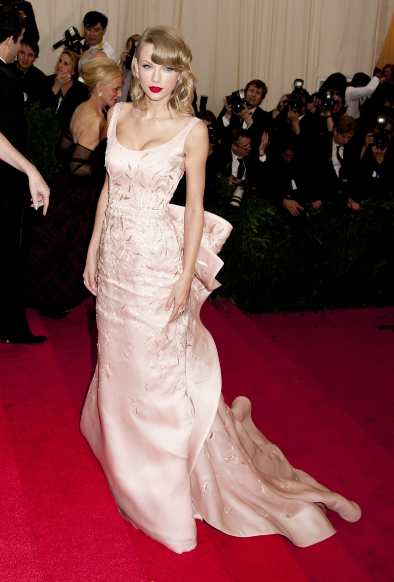 Taylor Swift looked just peachy in an Oscar de la Renta gown at the 2014 Met Gala. With a big bow embellishment on the back, Taylor channeled Old Hollywood Glamour at its best. Photo: Janet Mayer / PRPhotos.com