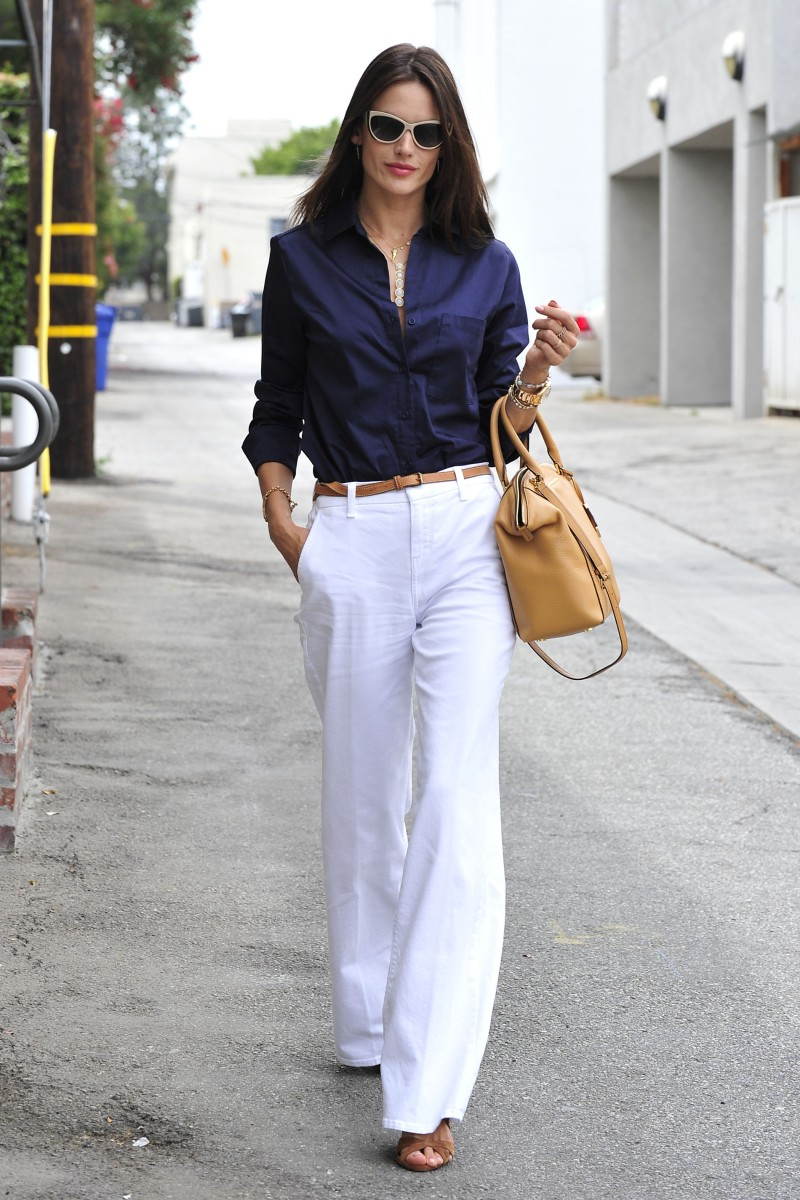 MAY 2015: Pictured in Los Angeles, Alessandra Ambrosio's street style featured a navy shirt, white trousers and a Michael Kors Riley satchel bag with Michael Kors Caneel sunglasses. Photo: StarTraks Photo