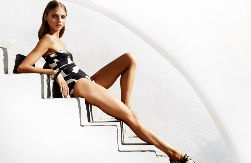 Anna lounges in a graphic, one-piece bathing suit