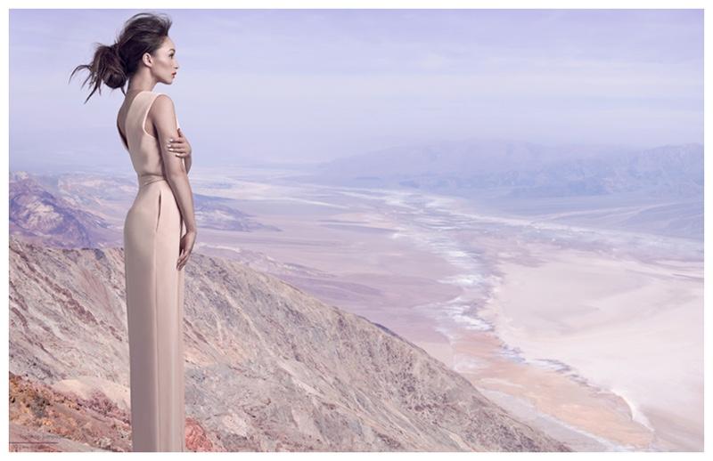 Cara Santana wears a nude hued long dress.