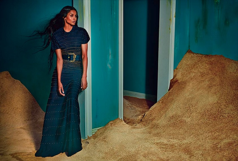 Ciara wears an embroidered gown with a statement belt