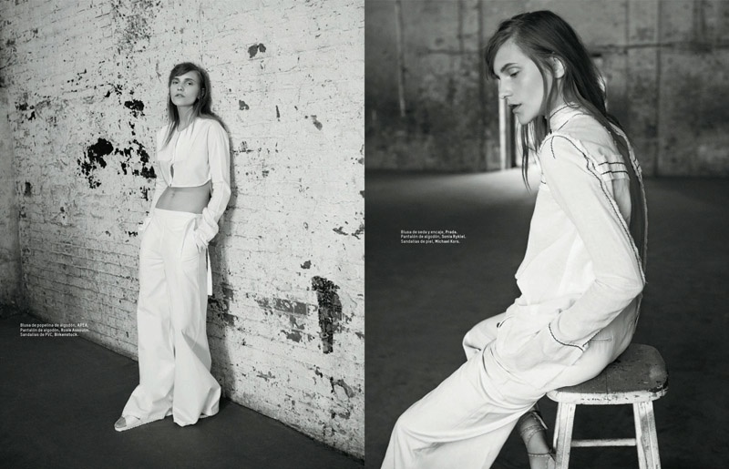 Dorothea wears relaxed silhouettes including baggy pants and a crop top