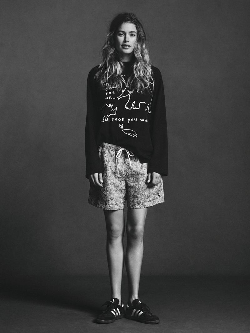 The L'Oreal Paris face keeps it casual in a long-sleeve shirt and baggy shorts