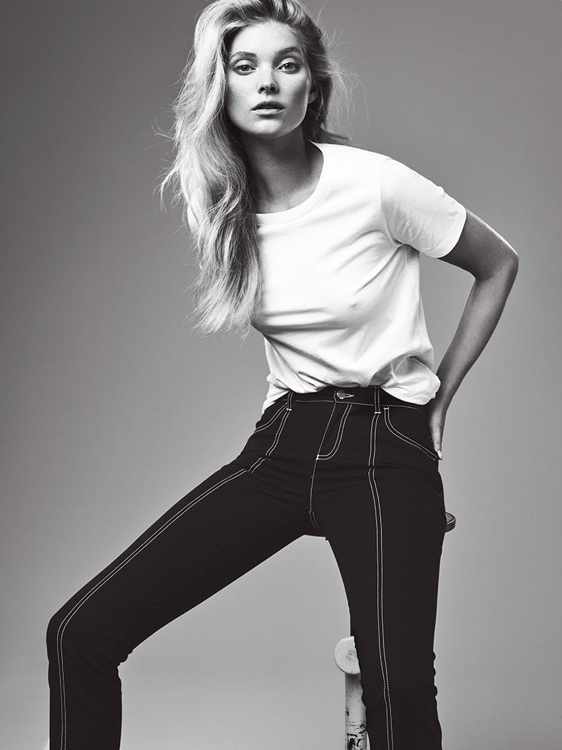 Elsa models a casual white tee with high-waist denim pants